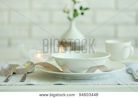 Beautiful holiday table setting in white and gray color