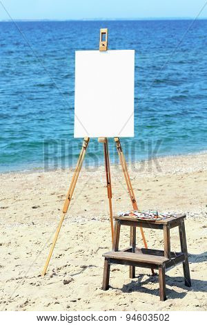 Easel with canvas on beach