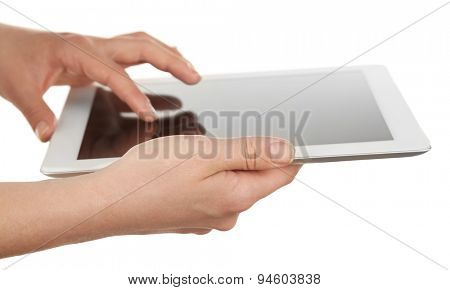 Hands holding tablet isolated on white