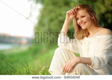 Smiling Girl In Sunset Near River