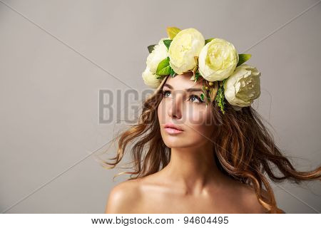 Woman in Flower Wreath with Waving Hair