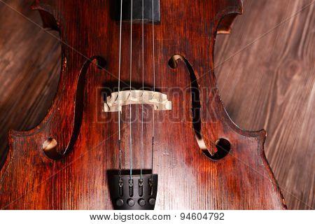 Vintage cello on wooden background