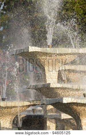 Closeup of stone fountain with dripping water