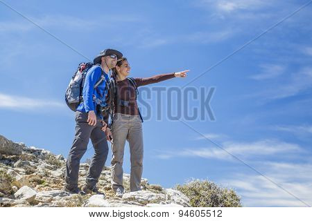 Couple Pointing At The Mountain