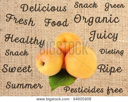 Fresh  apricots and words around on sackcloth background
