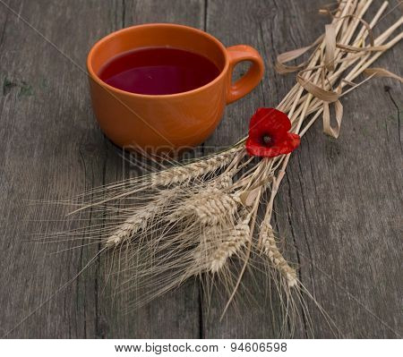 Big Orange Mug Of Juice And Stalks Of Wheat