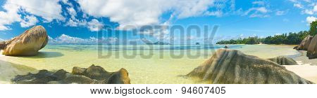 Beautifully shaped granite boulders and turquoise blue water at Anse Source d'Argent beach, La Digue island, Seychelles. Panoramic photo