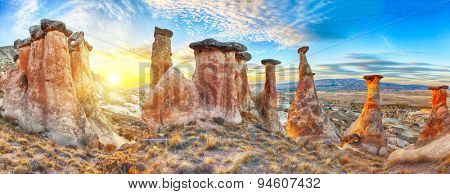 Rocks looking like mushrooms dramatically lit by a sunset in Cappadocia, Turkey