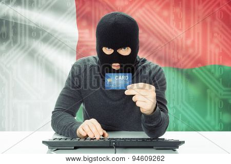 Concept Of Cybercrime With National Flag On Background - Madagascar
