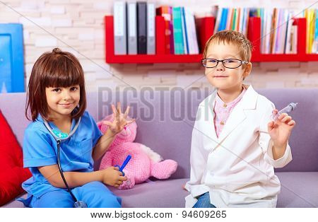 Cute Kids Playing In Doctors With Toy Instruments