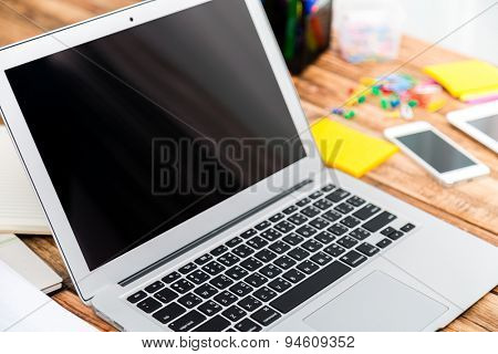 laptop computer on wood table
