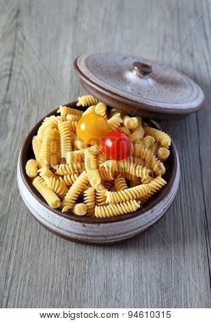 Pasta Fusilli And Two Cherry Tomatoes