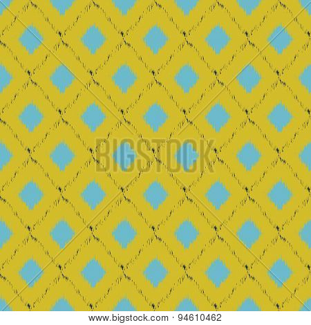 Seamless ikat pattern in yellow and grey colors. Vector tribal background