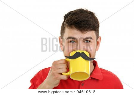 Portrait of man drinking from cup with cutout mustache, isolated on white