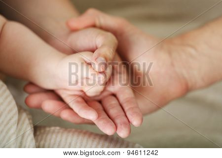 Adult and baby hands, closeup