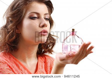 Beautiful woman with perfume bottle isolated on white