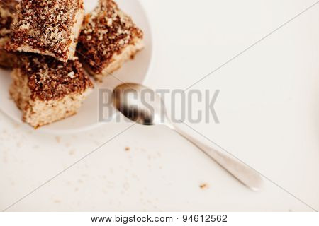 Delicious Coconut Biscuits On White Plate With Spoon  Top View With Free Space