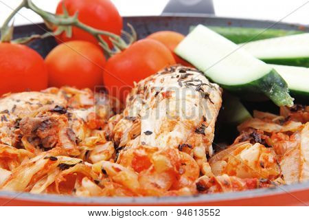 meat grilled chicken fillet cooked with vegetables on ceramic pan isolated over white background