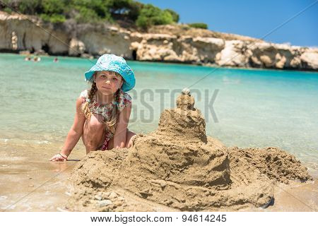 Little Girl Building Sand Castle