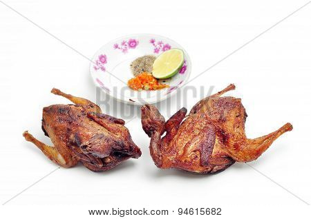 Vietnamese grilled quail on a white background