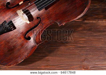 Vintage cello on wooden background