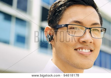 Headshot Business Man With Wireless Handsfree Device