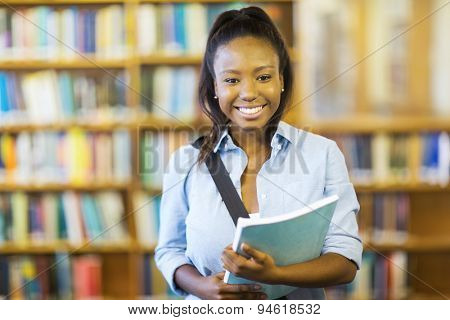 happy female african college student holding a book