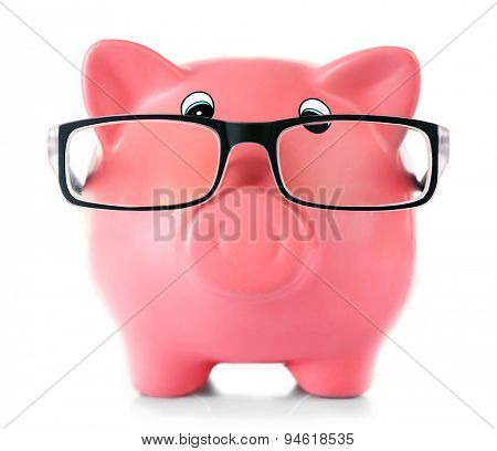 Piggy bank with glasses isolated on white