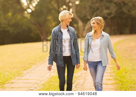 beautiful mother and daughter walking in the forest