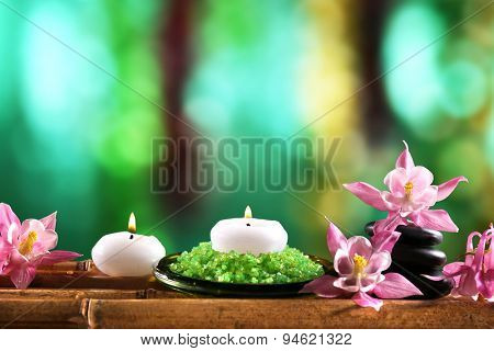 Beautiful spa composition with flowers and candles on bright background