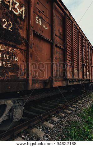 Railroad boxcars parked in a railway yard.