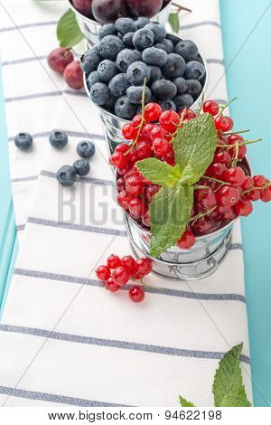 Red Currants And Blueberries In Small Metal Buckets