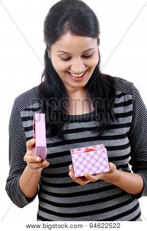 Happy Woman Opening A Gift Box