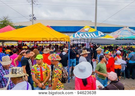 Multiple spectators watching the Carnival parade colorful vendors in Colombia's most important folkl