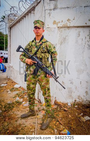 Colombian army soldier carrying an assault rifle AK 47 during Colombia's most important folklore cel