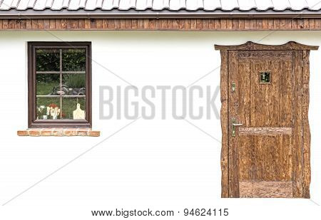 Door And Window On The Facade Of A House.