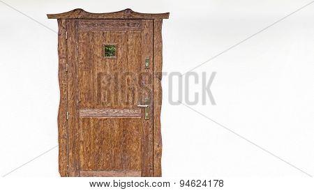 Wooden Door On The White House Facade.