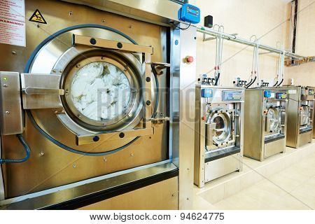 cleaning services. industrial laundry washing machine with cloth