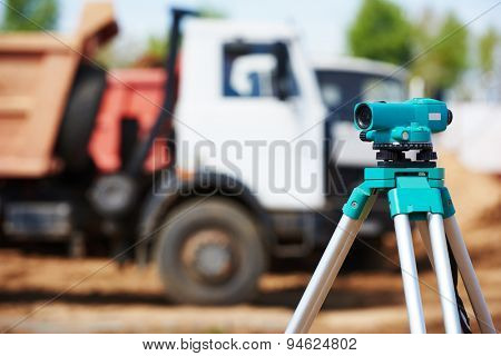 Surveyor equipment level theodolite outdoors at construction site