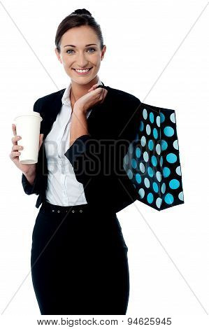 Woman Holding Coffee Cup And Shopping Bag