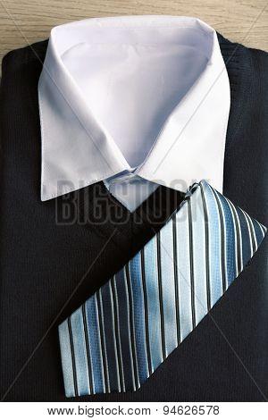 Men elegance clothes on wooden table, closeup