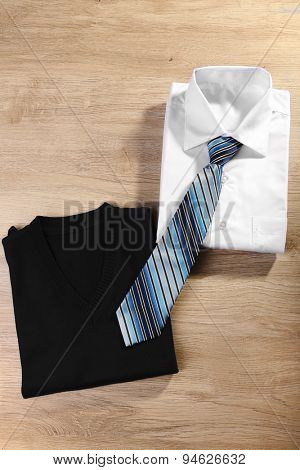 Men elegance clothes on wooden table, top view