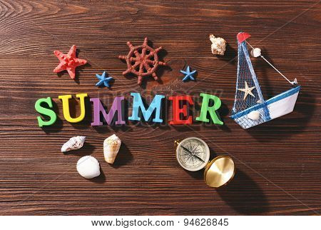 Word summer on wooden background