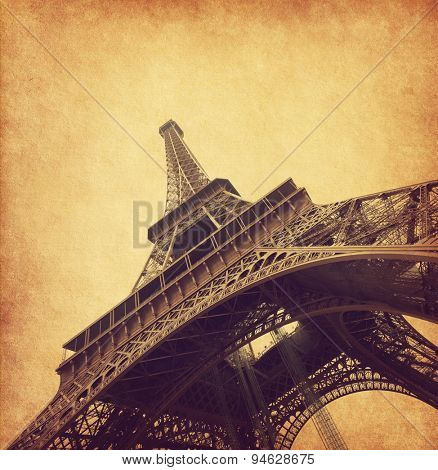 Eiffel tower. Photo in retro style. Added paper texture.