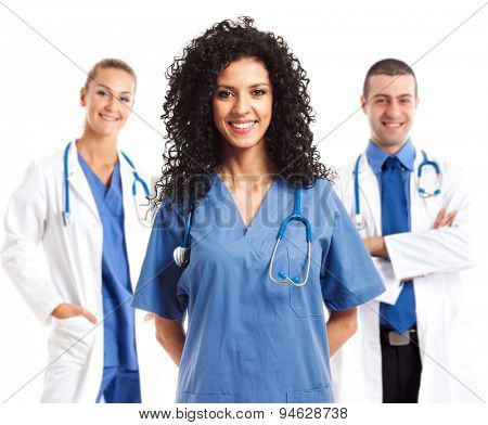 Portrait of a smiling nurse in front of her team