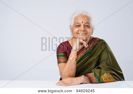 Senior Woman In Traditional Clothes