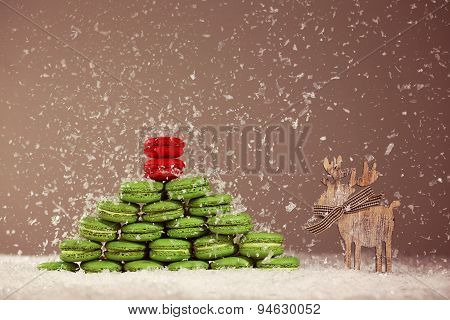 Green And Red Macaroons With Snow