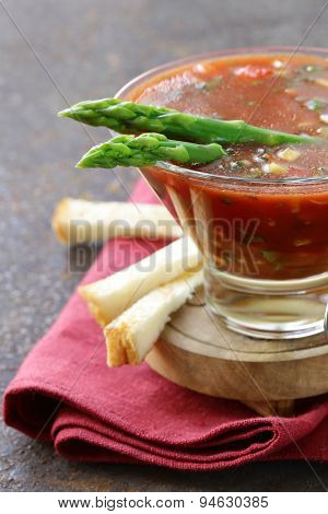 traditional Spanish cold tomato soup gazpacho with green asparagus and crackers
