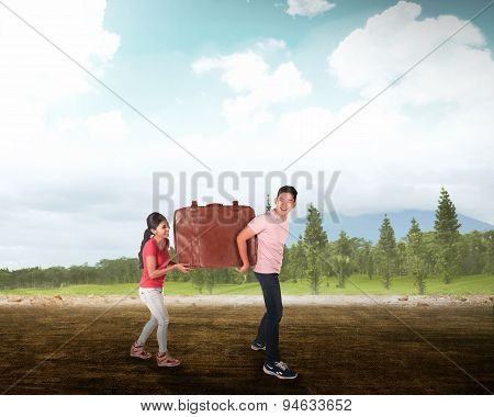 Young Couple Carry Big Baggage