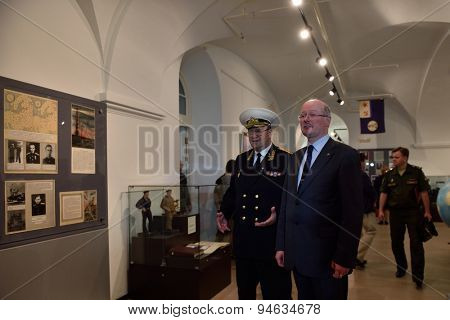 ST. PETERSBURG, RUSSIA - JUNE 24, 2015: Admiral Y. Sysuyev and vice president of Russian Geographical Society K. Chistyakov on the exhibition